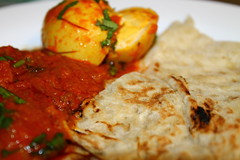 Egg and potato curry served with nan
