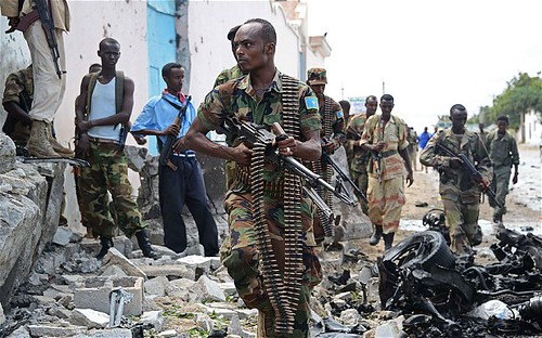 Somalian soldiers outside the United Nations compound that was bombed on June 18, 2013. The Al-Shabaab organization claimed responsibility. by Pan-African News Wire File Photos
