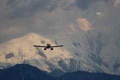 bird of prey(0.0), eagle(0.0), extreme sport(0.0), bird(0.0), condor(0.0), alps(1.0), cloud(1.0), airplane(1.0), mountain(1.0), arctic(1.0), wing(1.0), snow(1.0), mountain range(1.0), sky(1.0), flight(1.0), mountainous landforms(1.0),