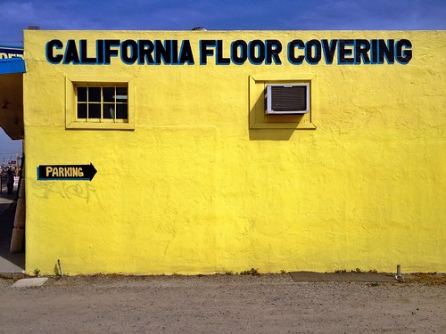 california street city blue shadow sky urban building window sign yellow wall landscape gold golden view floor parking mario neighborhood business handpainted arrow lettering stockton covering signpainter