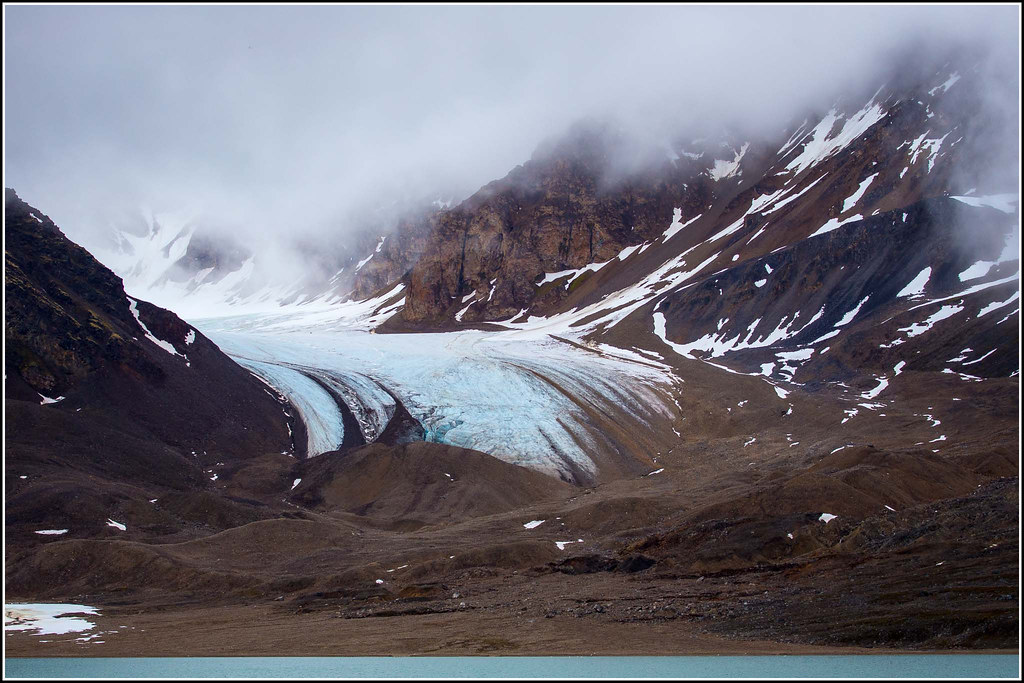 A Glacier and Terminal Moraine at Tinayrebukta.