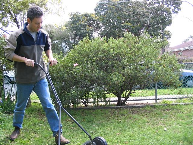 Mowing the garden in Carnegie, 2003