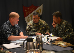 Rear Adm. Mark Montgomery, left, commander of the George Washington Strike Group; Rear Adm. Jaime Bernadino, center, vice commander of the Philippine Navy; and Commodore Reynaldo Yoma, commander of Naval Forces Command Central, discuss how to improve relief efforts aboard USS George Washington (CVN 73). (U.S. Navy photo by Mass Communication Specialist 2nd Class Shannon Heavin)