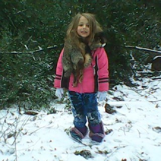 Zoe in the snow!  Yes, that is real animal fur.....