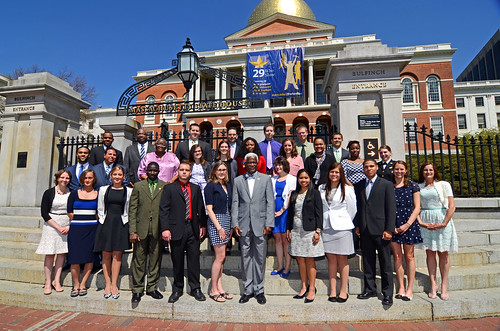29 Who Shine banner hanging on the front of the Massachusetts State House