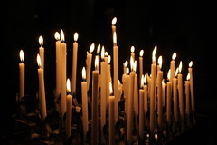 light fixture(0.0), street light(0.0), hanukkah(0.0), candle(1.0), light(1.0), candle holder(1.0), darkness(1.0), flame(1.0), lighting(1.0),