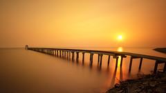Wooded bridge at sunset