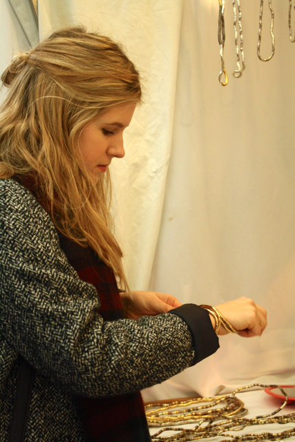 Trying on jewellery at the Greenwich Market, Greenwich