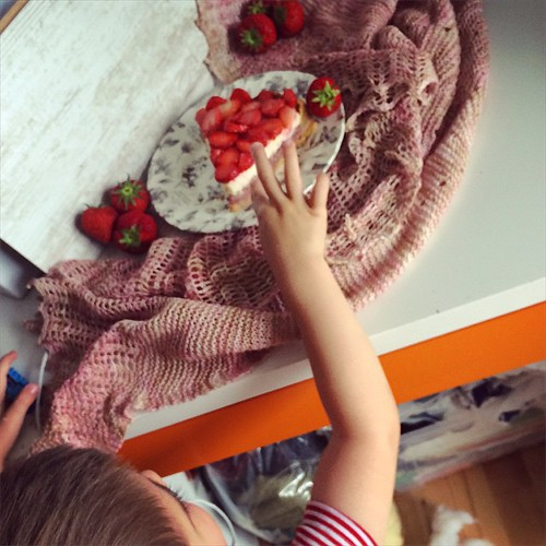 #tbt Last summer when I photographed my #BakeKnitSew book. Food stylists are getting younger and younger. That's a strawberry mascarpone tart atop my Falling Petals lace shawl.