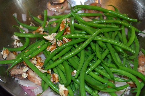 Adding the haricot verts and pecans