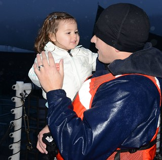 ASTORIA, Ore. - Seaman Jonathan Dipalma, deck crewmember aboard Coast Guard Cutter Alert, is reunited with his daughter Ayla at the 17th Street Pier in Astoria, Dec. 20, 2013.  Cutter Alert's crew returned to Astoria after an 81-day patrol covering more than 12,000 miles.  U.S. Coast Guard photo by Petty Officer 3rd Class Nate Littlejohn