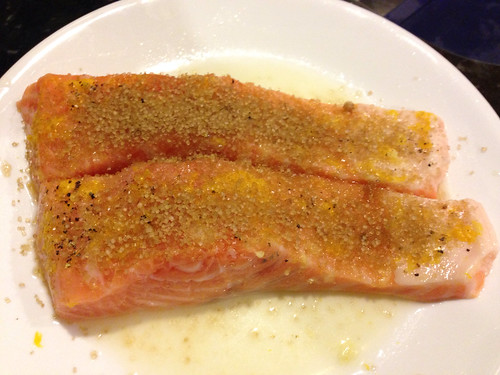 Salmon prepped for the broiler with side pocket's lemon zest and brown sugar on top.