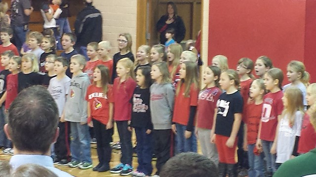 Mimi singing at bball game
