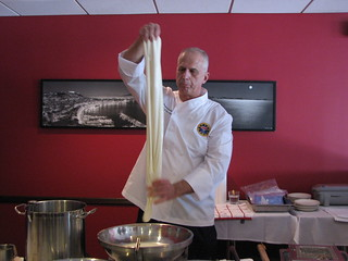 Stretching fresh mozzarella cheese