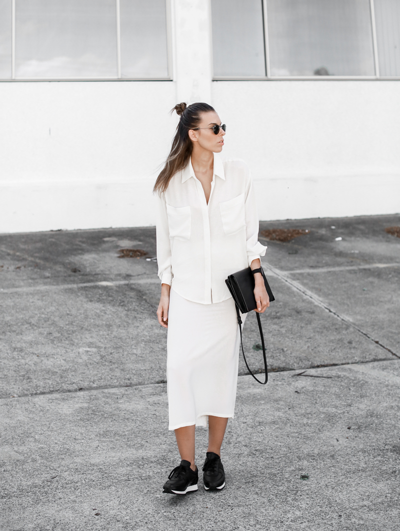 MODERN LEGACY sport luxe street style white on white midi skirt Common Projects sneakers half up hair (1 of 1)