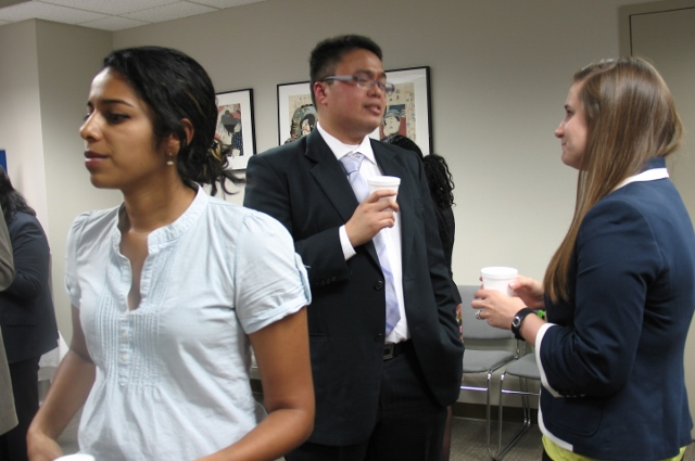 East-West Center Visiting Fellow Julio Amador III chats with one of the USSP/USTL internship supervisors. This annual gathering also serves as a