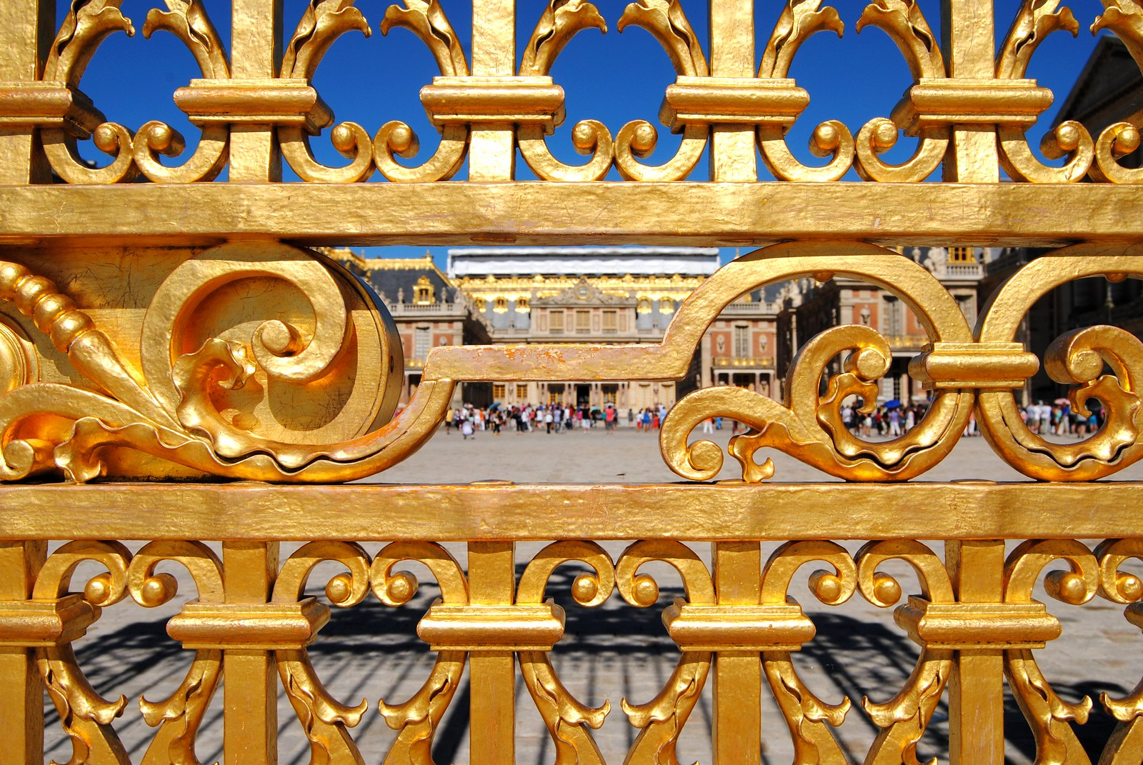 The golden gate in front of the Chateau de Versailles