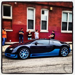 model car(0.0), automobile(1.0), bugatti(1.0), automotive exterior(1.0), wheel(1.0), vehicle(1.0), automotive design(1.0), bugatti veyron(1.0), land vehicle(1.0), supercar(1.0), sports car(1.0),