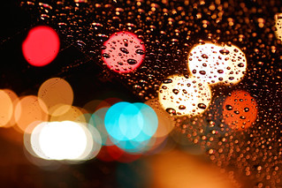 rain & traffic lights t;hrough a windshield