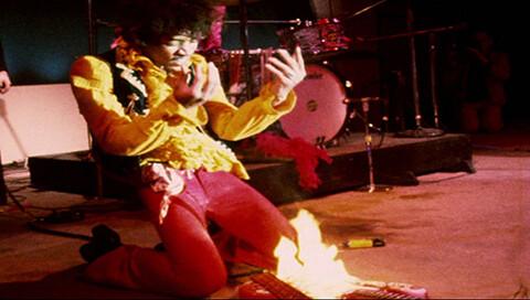 Jimi Hendrix Playing Guitar On Fire