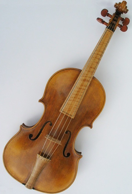 A baroque violin, with gut strings and no chin rest