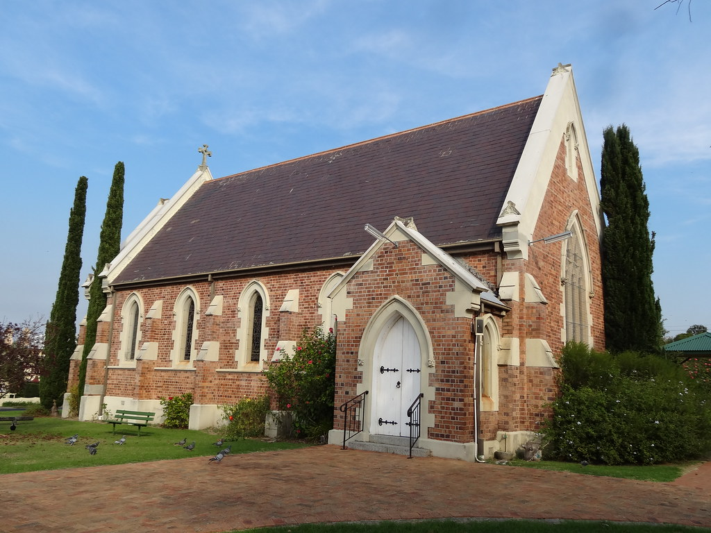 Moruya. Established 1850. Known as granite town. Only the Anglicans chose not to build their church in granite. They used red bricks instead. Architect Edmund Blackets son. Built 1891. Foundation stone laid by Mrs Mort of Bodalla.