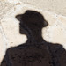 Small photo of Shadow of a man with a hat