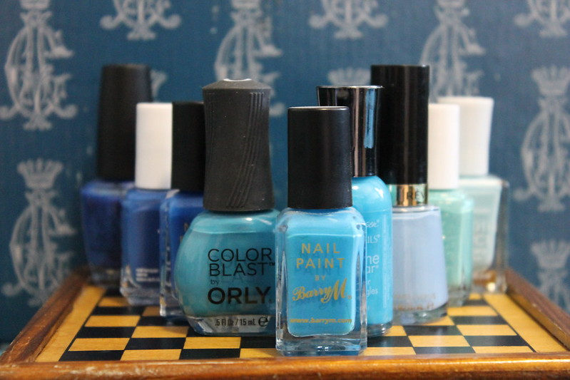 nine bottles of blue nail polish