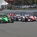 Justin Wilson and James Hinchcliffe lead the field down the frontstretch for a restart of the GoPro Grand Prix of Sonoma