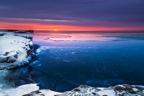 winter sunset sun lake chicago cold ice clouds sunrise season frozen illinois twilight rocks unitedstates jetty cliffs lakemichigan il evanston hanusiak polarvortex