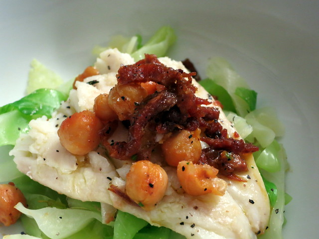 Olive oil poached cod, chickpeas, cabbage, Spanish chorizo