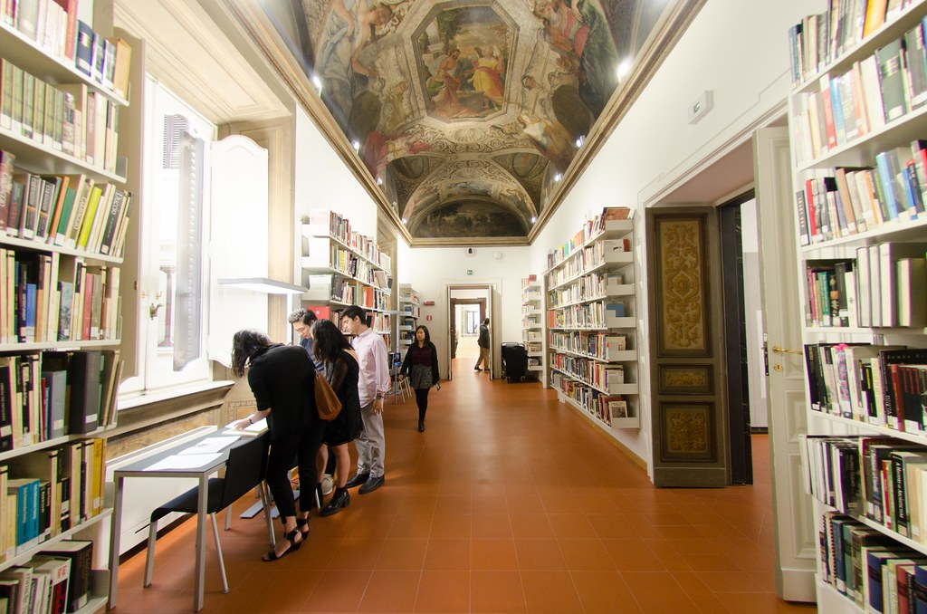The library ceiling fresco runs the length of the room and the two architecture studios are accessible from the space.