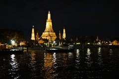 Wat Arun, the temple of dawn, by the Chao Phraya river in Bangkok, Thailand, at night