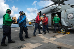 Sailors assigned to the littoral combat ship USS Freedom (LCS 1) pack the cabin of an SH-60 Seahawk helicopter with supplies from Project Handclasp for delivery ashore in Tacloban, Nov. 24. (U.S. Navy photo by Mass Communication Specialist 3rd Class Karolina A. Oseguera)