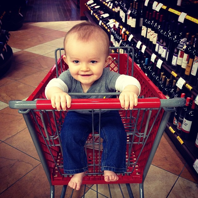 Not only is my baby sockless, but he's in a liquor store and excited to be surrounded by wine. Can you blame him? #winningatparenting
