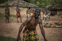 Villagers from Gouleako, one of the many villages outside Côte d'Ivoire's Taï National Park  perform a traditional ceremony for tourists. Credit: Marc-André Boisvert/IPS
