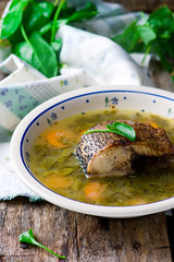 Soup with a sorrel and fish. Selective focus.