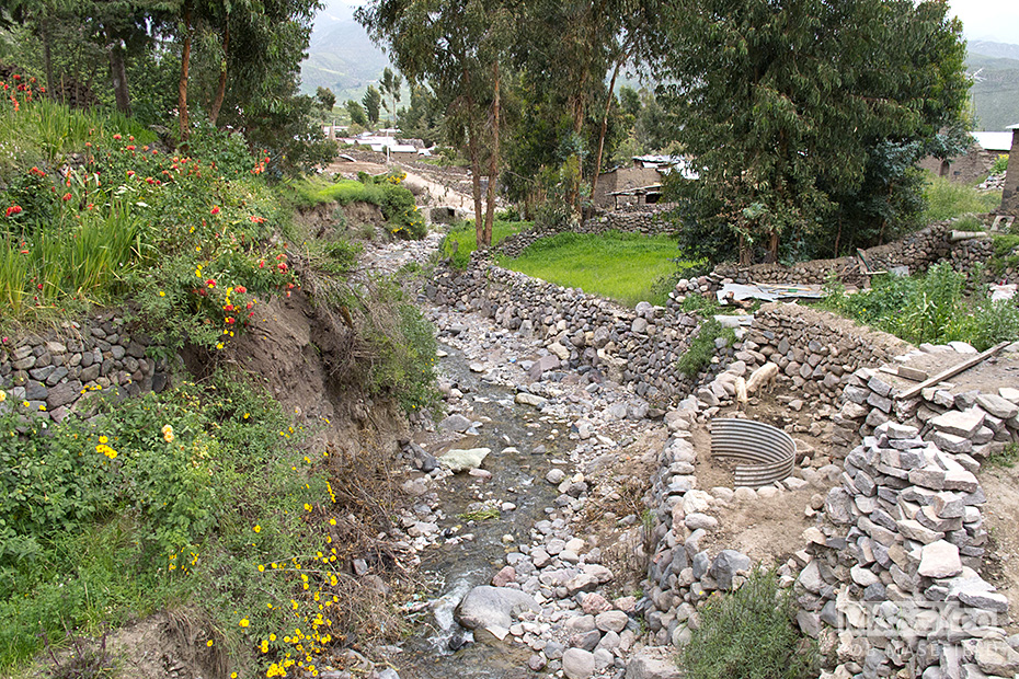 Water is delivered throughout the village via stone channels.