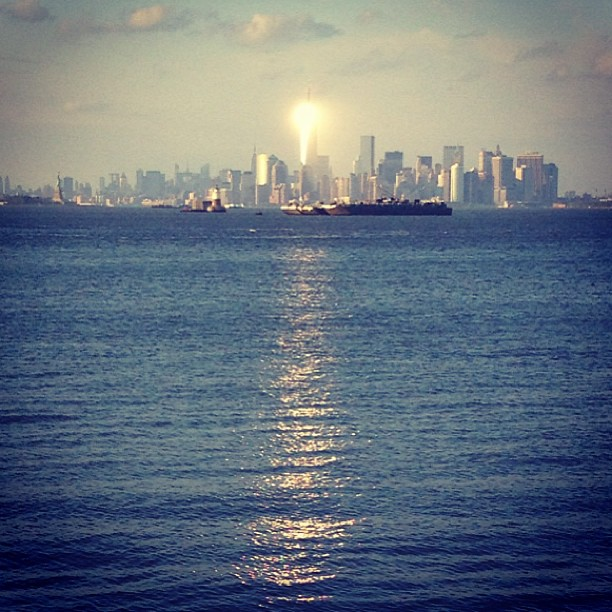 While sitting on Staten Island, just in front of the stadium, I suddenly felt like I had a spotlight shining on me and when I looked over- I could see that the sun was reflecting a beam directly at me bounced off of the Freedom Tower.  I knew how rare and