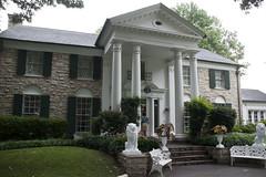 backyard(0.0), outdoor structure(0.0), orangery(0.0), cottage(0.0), residential area(0.0), lawn(0.0), courtyard(1.0), building(1.0), garden(1.0), farmhouse(1.0), property(1.0), porch(1.0), yard(1.0), house(1.0), estate(1.0), siding(1.0), mansion(1.0), villa(1.0), facade(1.0), home(1.0),