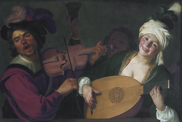 A merry group behind a balustrade with a violin and a lute player by Gerrit van Honthorst (1590–1656)