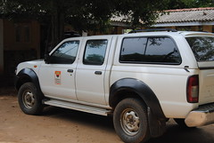 off-roading(0.0), automobile(1.0), automotive exterior(1.0), pickup truck(1.0), wheel(1.0), vehicle(1.0), truck(1.0), bumper(1.0), nissan navara(1.0), land vehicle(1.0),