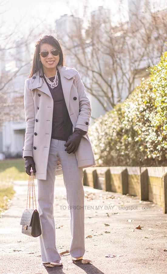 gray wool trench coat, black vest, purple tee, mixed metal necklace, purple gloves, gray pants, rose gold metallic wedges