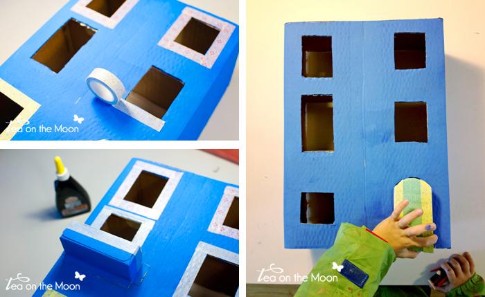 Casa con caja de cartón decoración