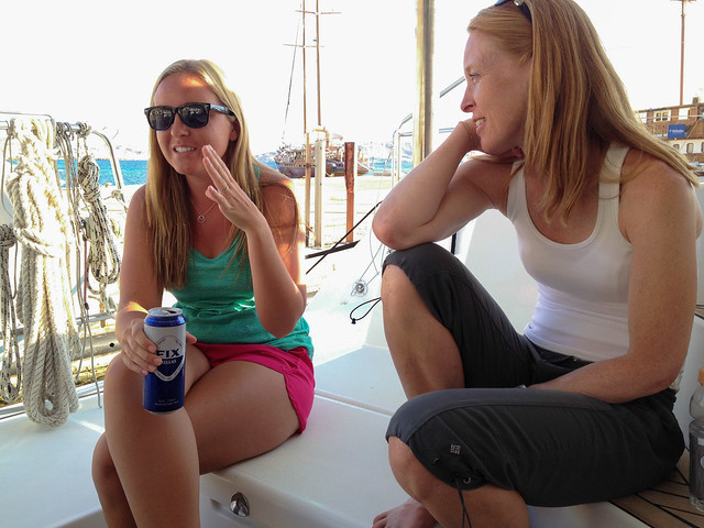Enjoying a drink on the boat in Mykonos new harbour