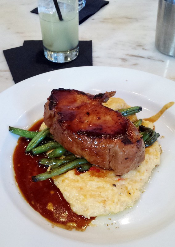 Merchant: Sweet Tea Pork Loin, Pimento Grits, Molasses Glazed Green Beans, Bourbon Jus