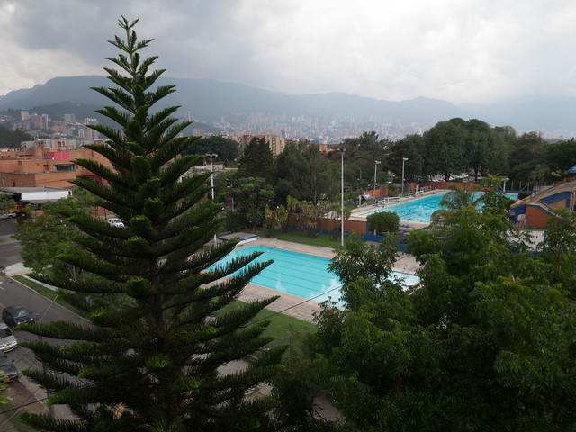 Public pools in the park across the street, with Poblado in the distance