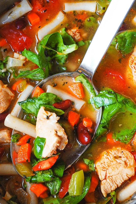 chicken soup with kidney beans, carrots, spinach, tomatoes, spices