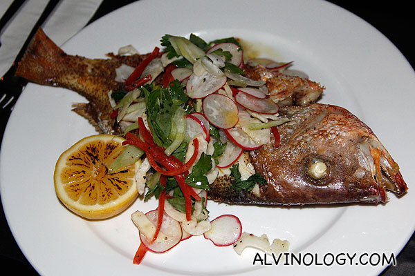 Whole roasted snapper (Crusted with cumin and fennel seeds served with herb salad) - S$27