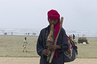 snake charmer on the beach..